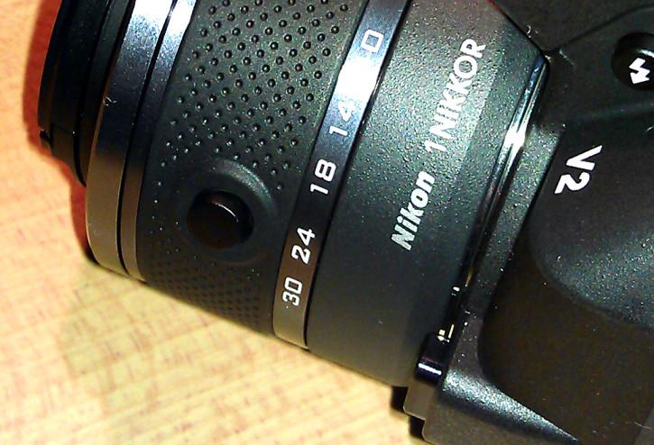 Nikon 1 V2 Tubusentriegelung